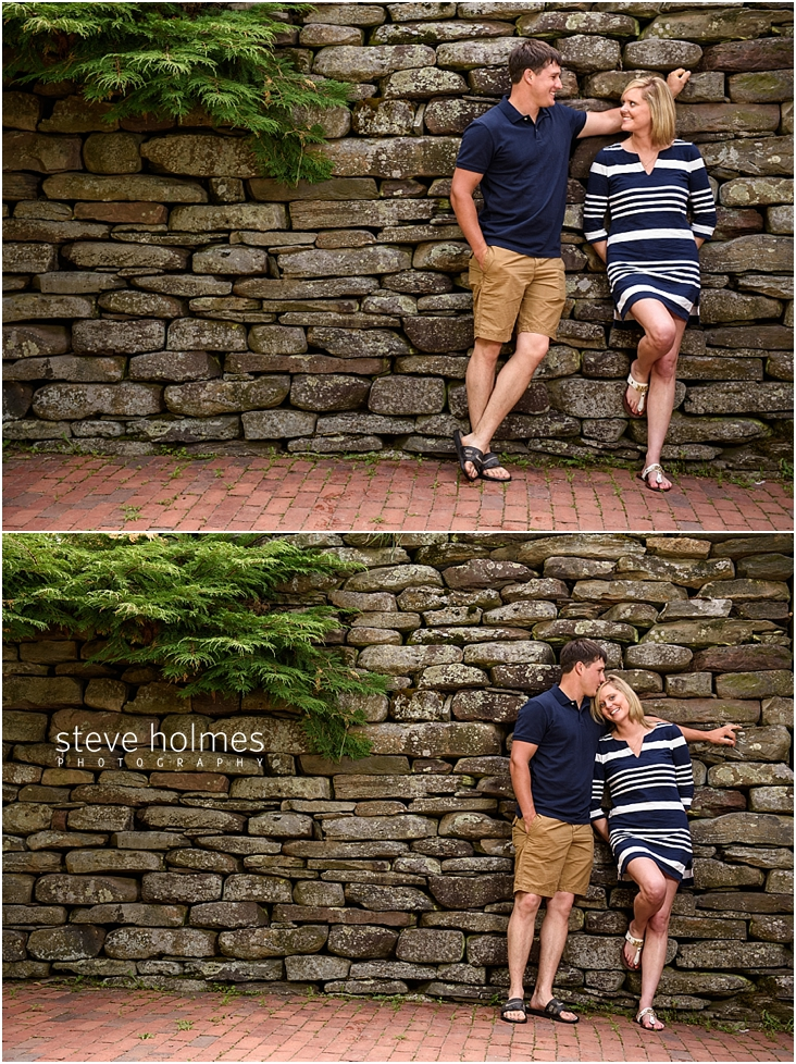 14_couple-leans-against-rock-wall