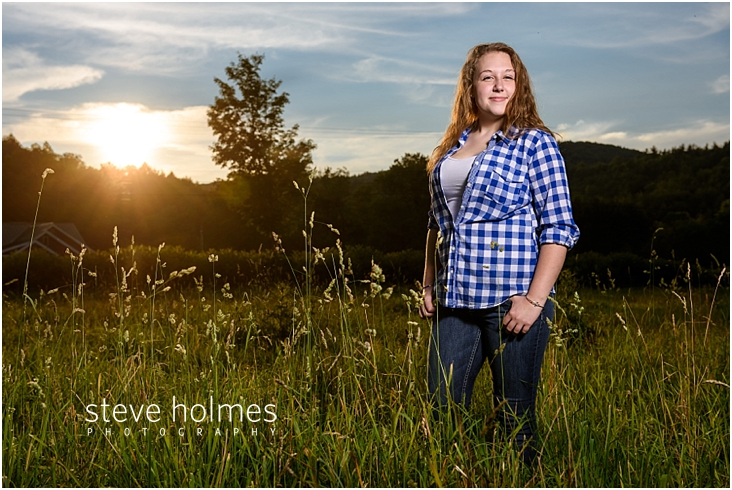 15_Keene-High-School-Senior-Pictures-Outdoors-Grass-Field-Blue-and-White-Plaid-Shirt-Crop-Jeans
