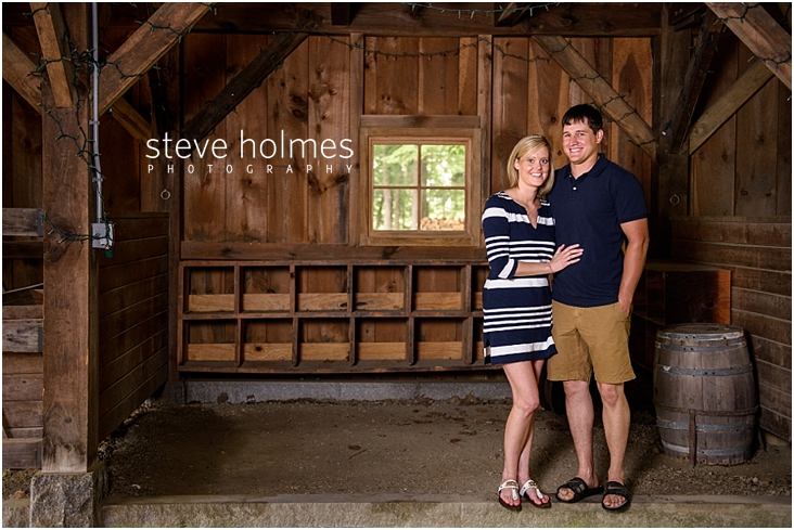 16_couple-stands-together-in-barn
