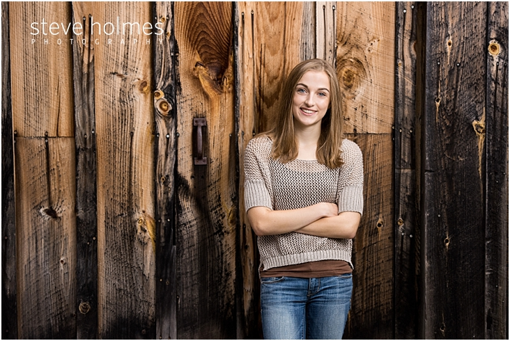 19_Keene-High-School-Senior-Pictures-Outdoors-Wood-Wall-Tan-Sweater-Jeans