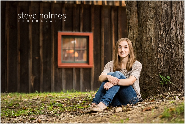 21_Keene-High-School-Senior-Pictures-Outdoors-Wood-Barn-Tan-Sweater-Jeans