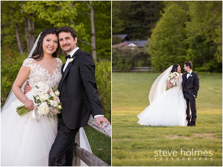 100_bride-and-groom-smile-standing-by-wooden-fence