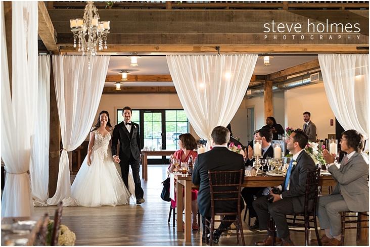 115_bride-and-groom-enter-reception