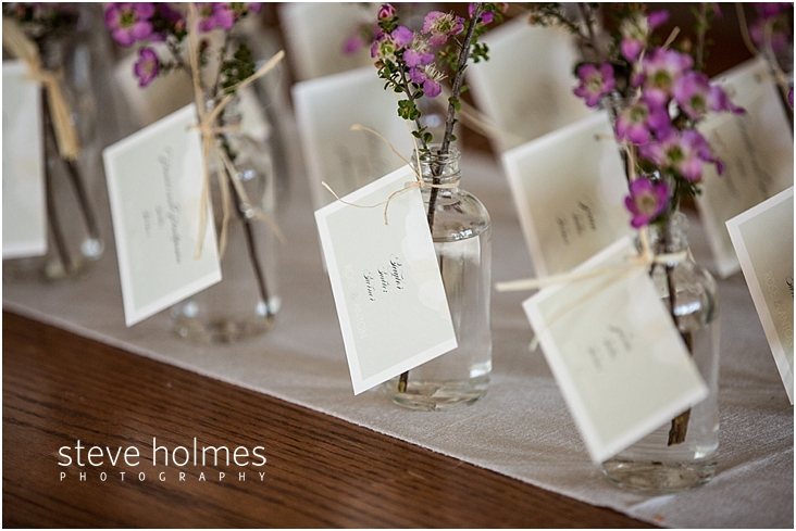 28_guest-name-cards-attached-to-clear-glass-vases