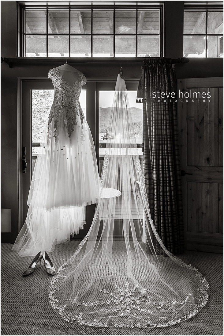 36_wedding-dress-and-veil-hanging-in-window-black-and-white