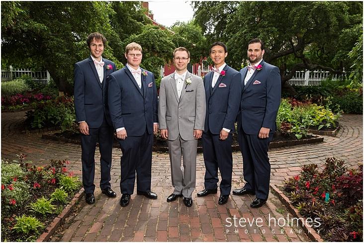 38_groom-wearing-gray-suit-stands-with-groomsmen-wearing-navy ...