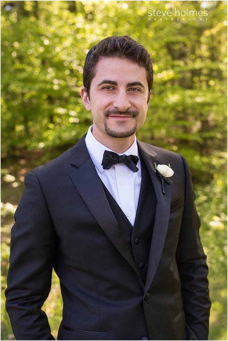 56_groom-smiles-wearing-his-tuxedo