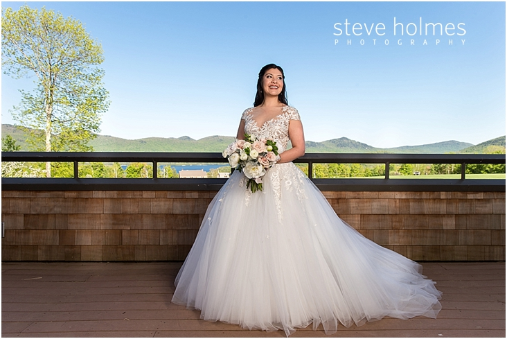 58_bride-smiles-on-balcony-with-mountains-in-background