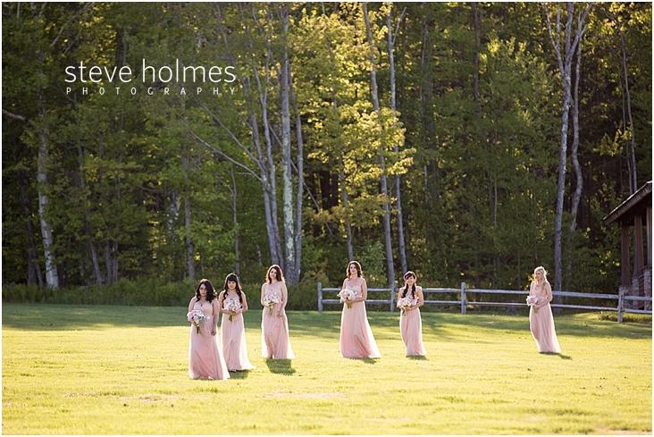 68_bridesmaids-walk-toward-ceremony