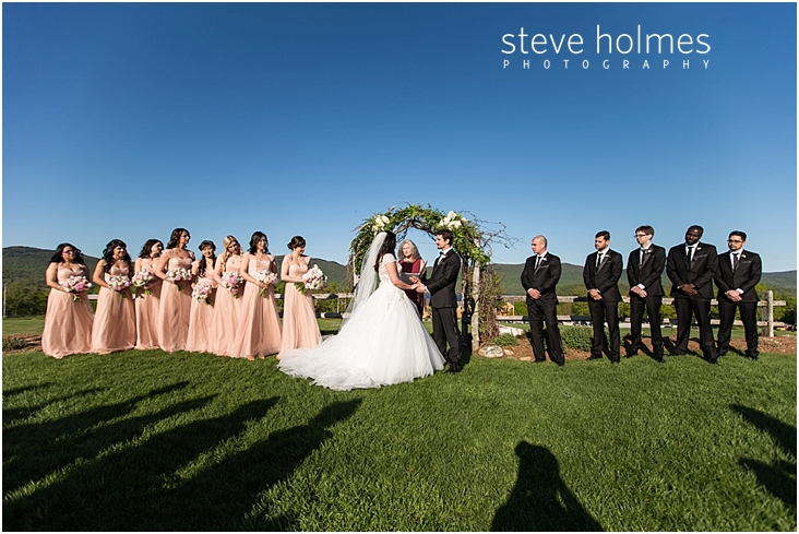 75_bride-and-groom-hold-hands-at-front-of-ceremony