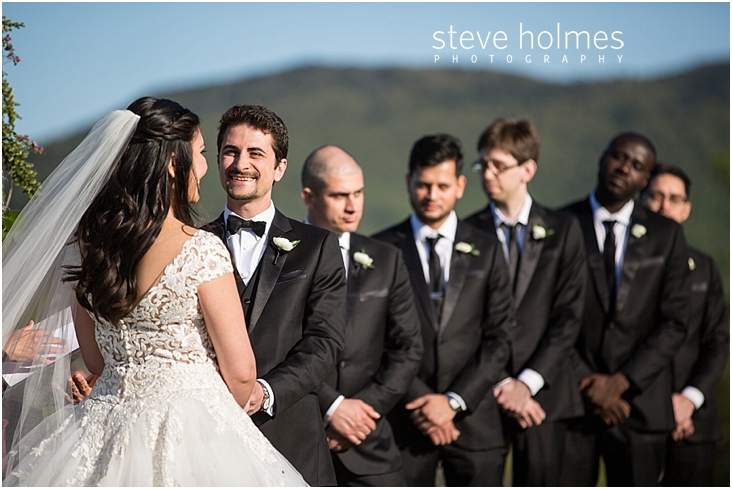 76_groom-smiling-at-his-bride-during-ceremony
