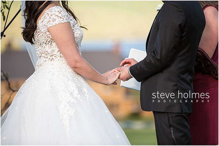 81_groom-places-ring-on-brides-finger