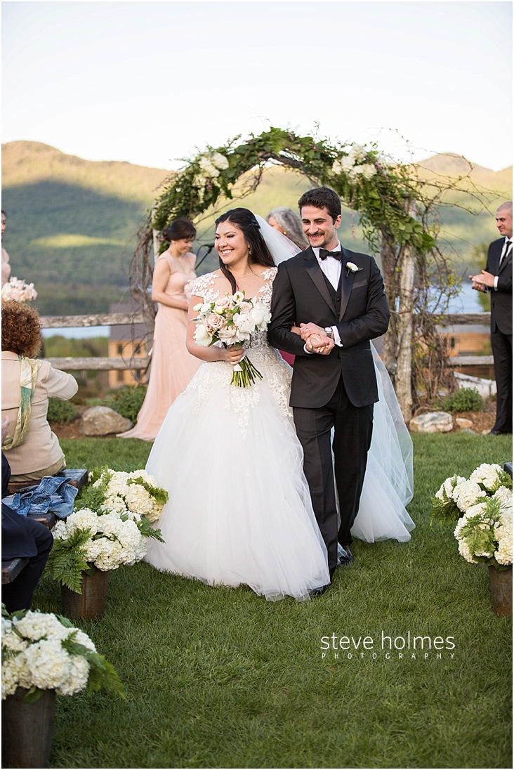 84_bride-and-groom-walk-down-aisle-together