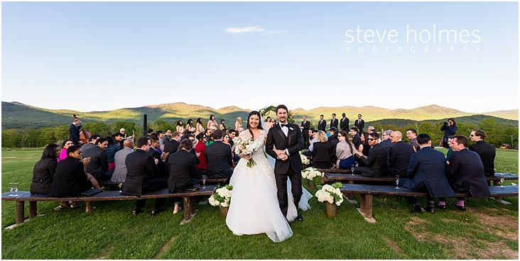 85_full-view-of-ceremony-when-bride-and-groom-walk-down-the-aisle