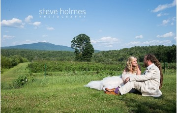 90_bride-and-groom-sit-in-grass-field