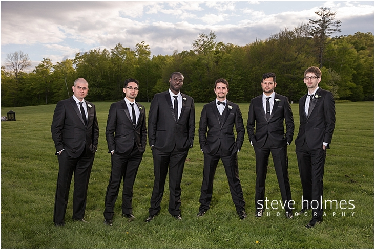 94_groom-and-groomsmen-stand-together-with-hands-in-pockets