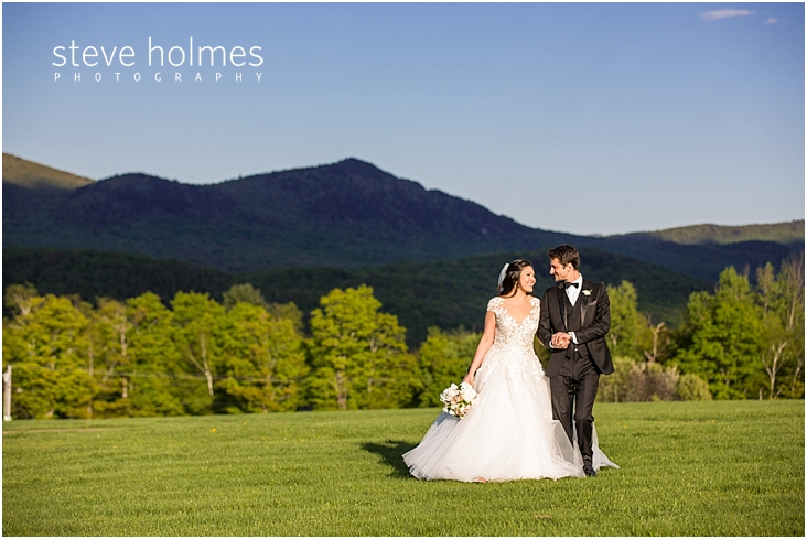 98_bride-and-groom-smile-at-each-other-with-mountains-in-background