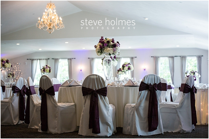 11_purple-sashes-on-white-chair-covers-at-reception