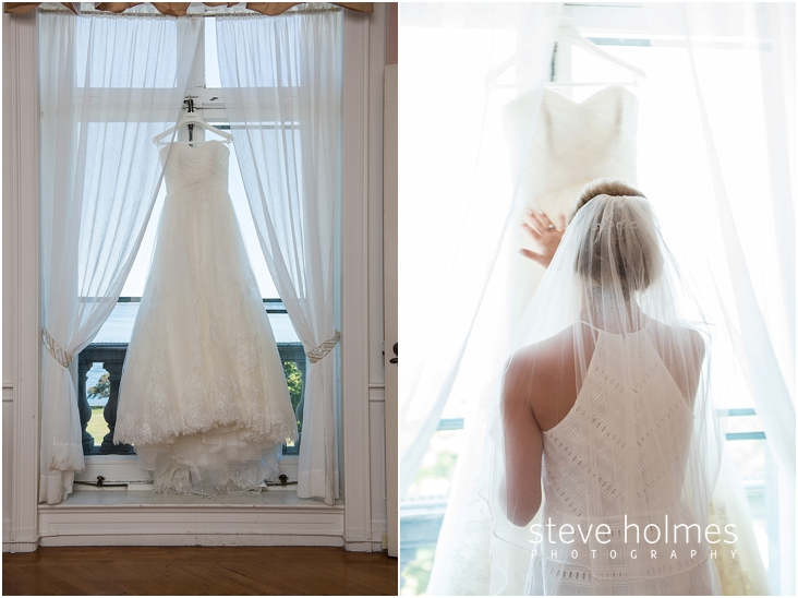 11_wedding-dress-hangs-in-front-of-window