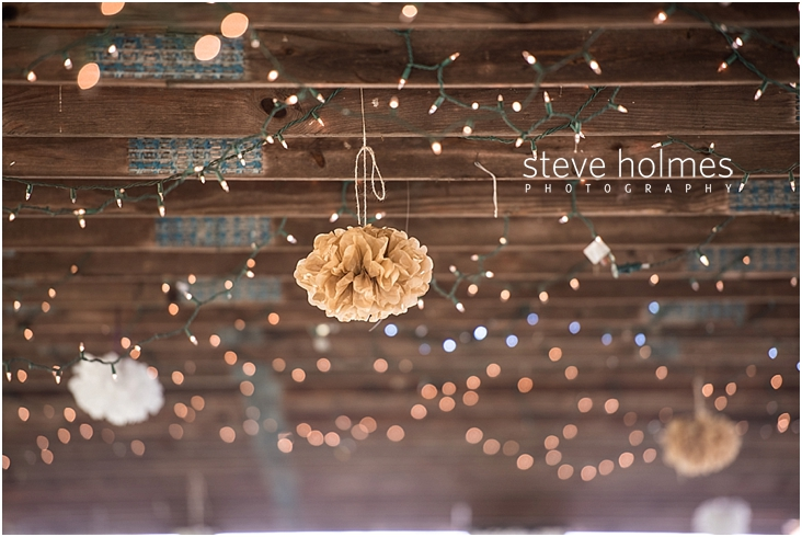 12_tan-tissue-paper-poms-hanging-from-ceiling-rafters