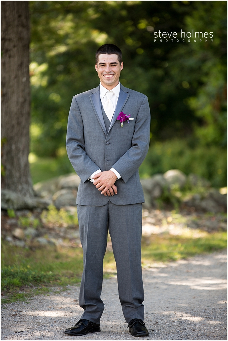 30_smiling-groom-standing-on-gravel-path