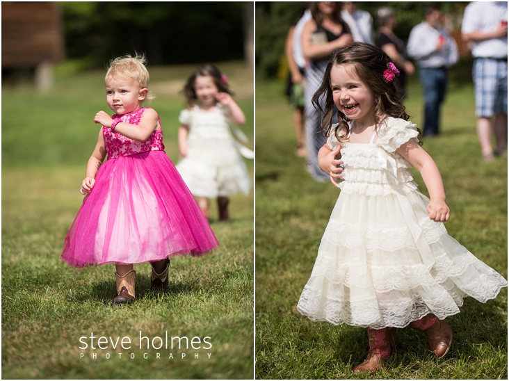 31_flower-girl-wearing-pink-dress-and-cowboy-boots-walks-down-aisle