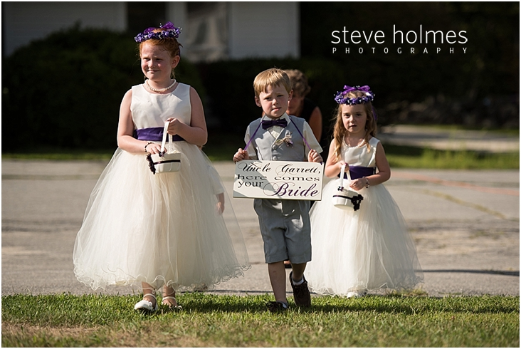 34_ring-bearer-holding-here-comes-your-bride-sign