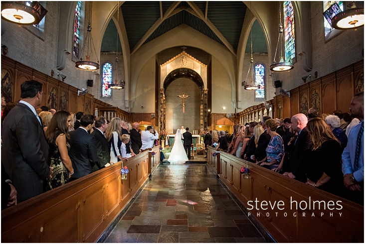 36_bride-and-groom-standing-together-at-front-of-church