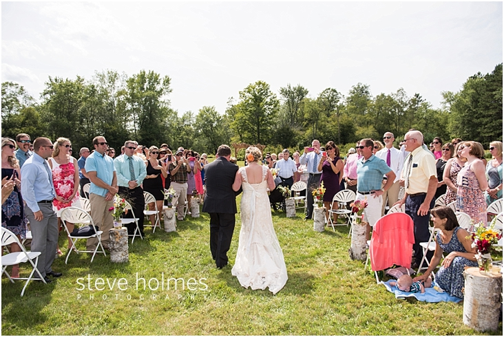 37_guests-stand-as-bride-walks-down-the-aisle-with-father