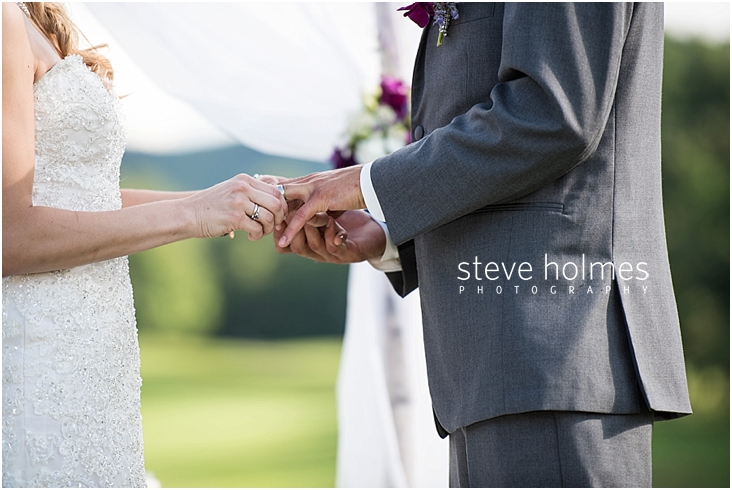 43_bride-places-ring-on-grooms-finger