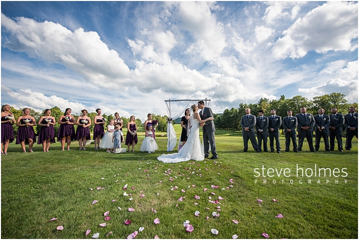 44_bride-and-groom-kiss-during-outdoor-ceremony