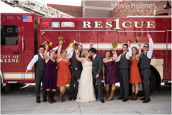 45_bride-and-groom-kiss-wedding-party-cheers-in-front-of-red-fire-truck
