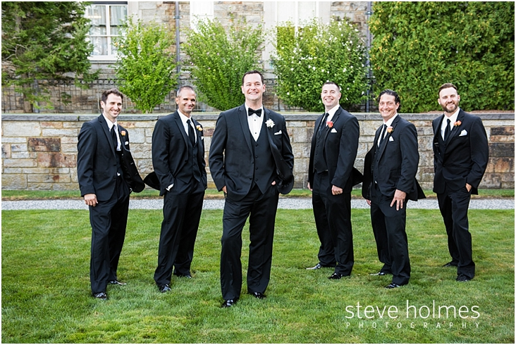 46_groom-and-groomsmen-stand-outside-with-hands-in-pockets