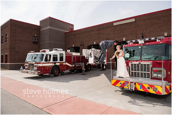 50_groom-on-fire-truck-ladder-lowered-down-for-a-kiss-from-bride