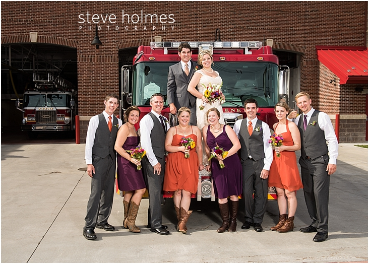 51_bride-and-groom-and-wedding-party-in-front-of-fire-truck