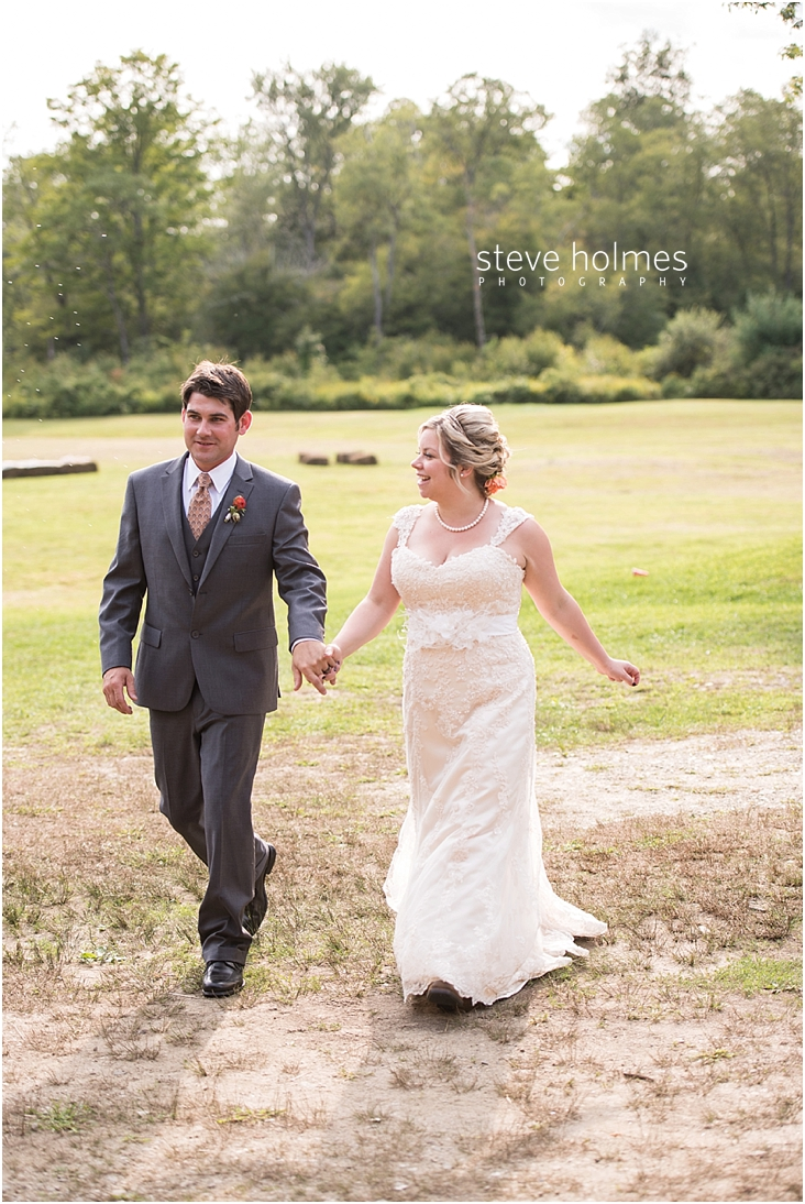 56_bride-and-groom-holding-hands-while-walking