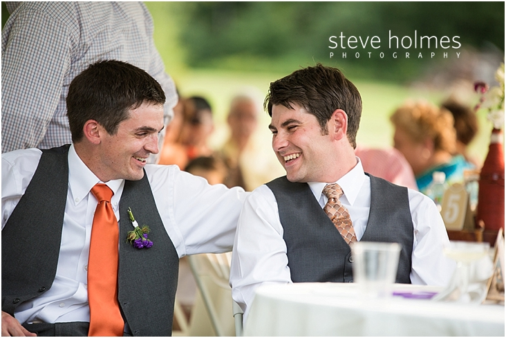 63_groom-laughs-with-groomsman-during-reception