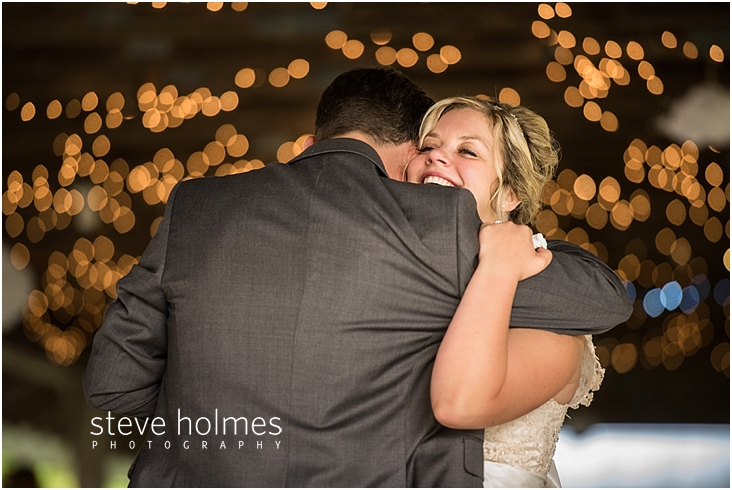 67_bride-smiling-during-first-dance-with-groom