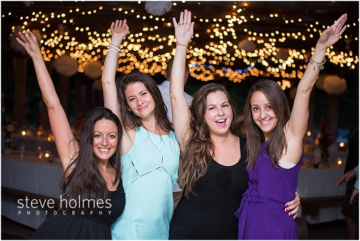 68_wedding-guests-with-arms-in-the-air-at-reception