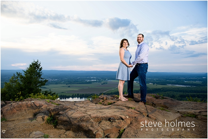 09_happy-couple-holding-hands-while-standing-on-rock