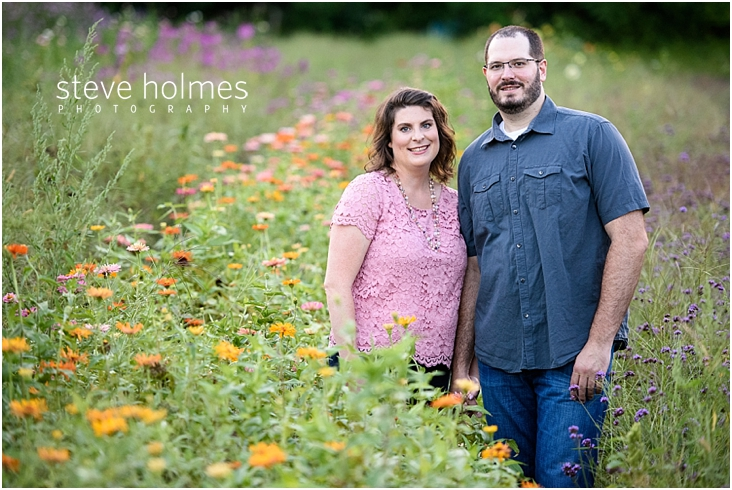 11_smiling-couple-standing-in-wild-flower-field