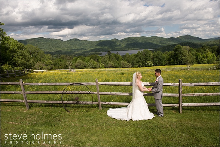 37_bride-and-groom-in-front-of-wood-fence_web