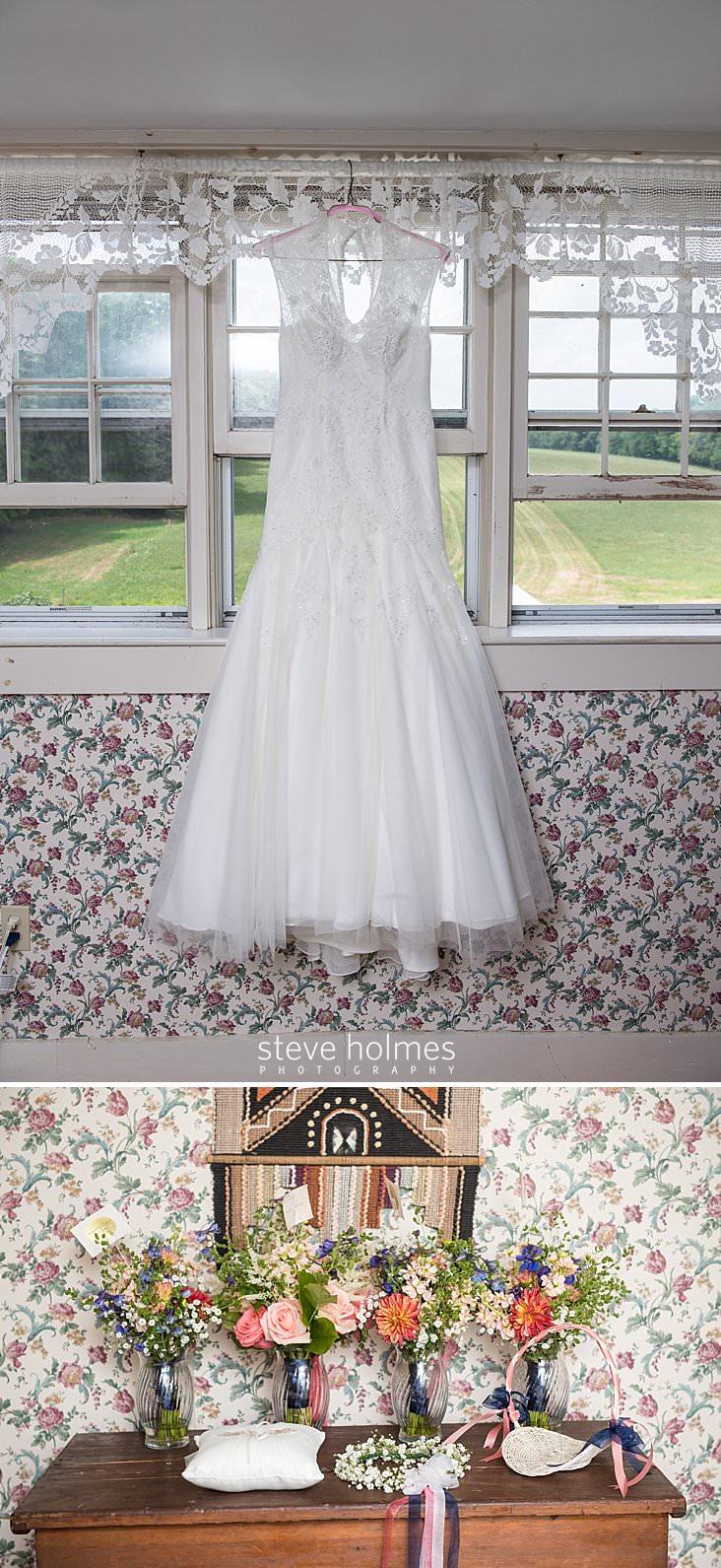 13_Wedding dress hangs in window.jpg