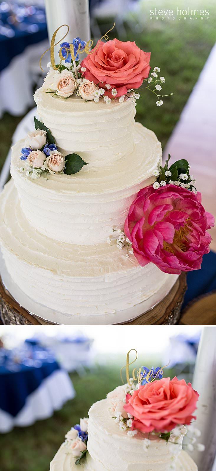 19_Three tiered wedding cake with flowers.jpg