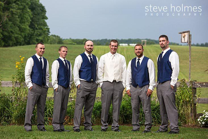 21_Groom in white vest and Groomsmen in grey pants and dark blue vests.jpg