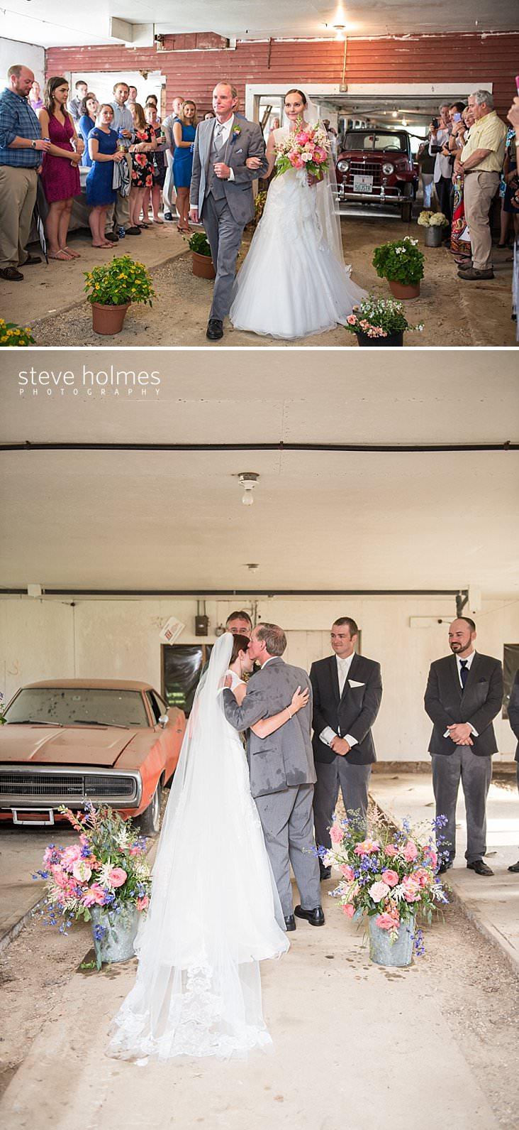 37_Bride and father walk down isle in barn.jpg