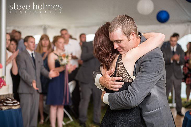 51_Groom hugs mother after dance.jpg