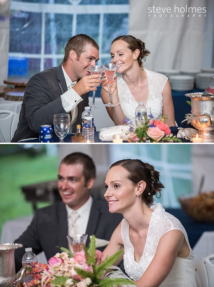 61_Bride and groom cheers with champagne glasses at head table.jpg