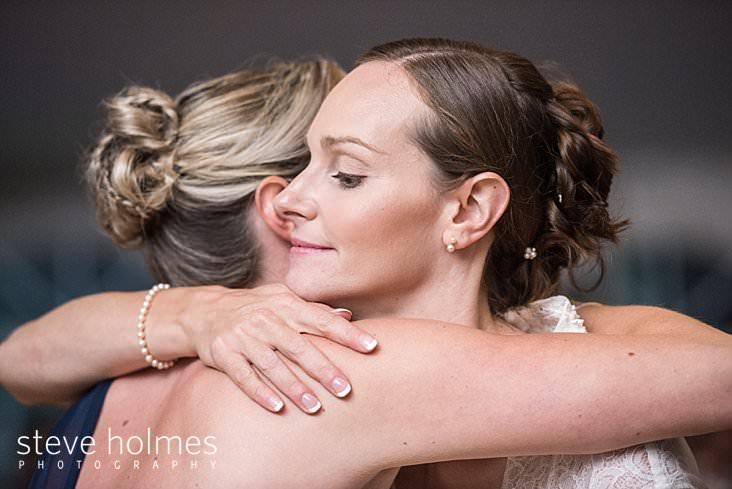 62_Bride hugs maid of honor.jpg