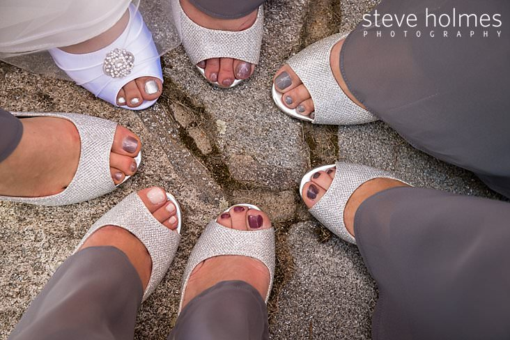 Bride and bridesmaids show off their painted toes in circle.jpg